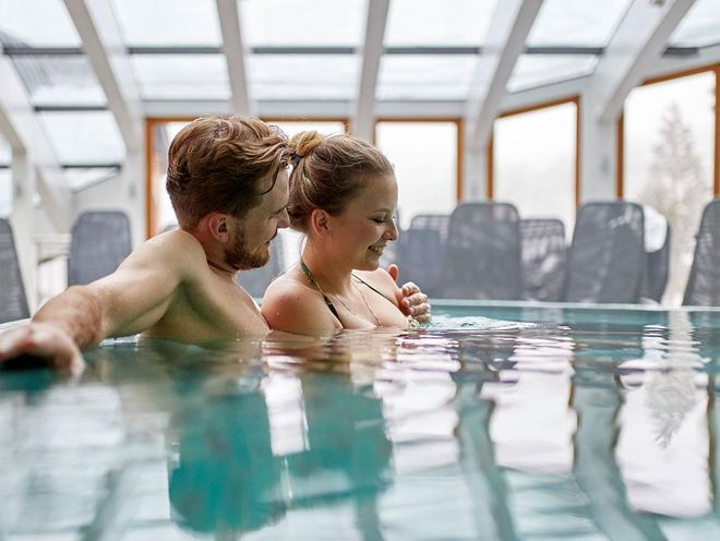 Relaxing together in the indoor swimming pool of the Hotel Hochschober