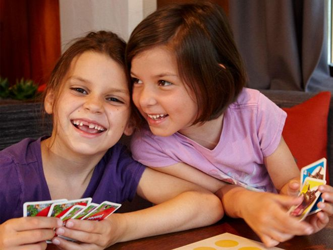 Playing cards and having fun in the children's villa in the Hotel Hochschober on the Turracher Höhe
