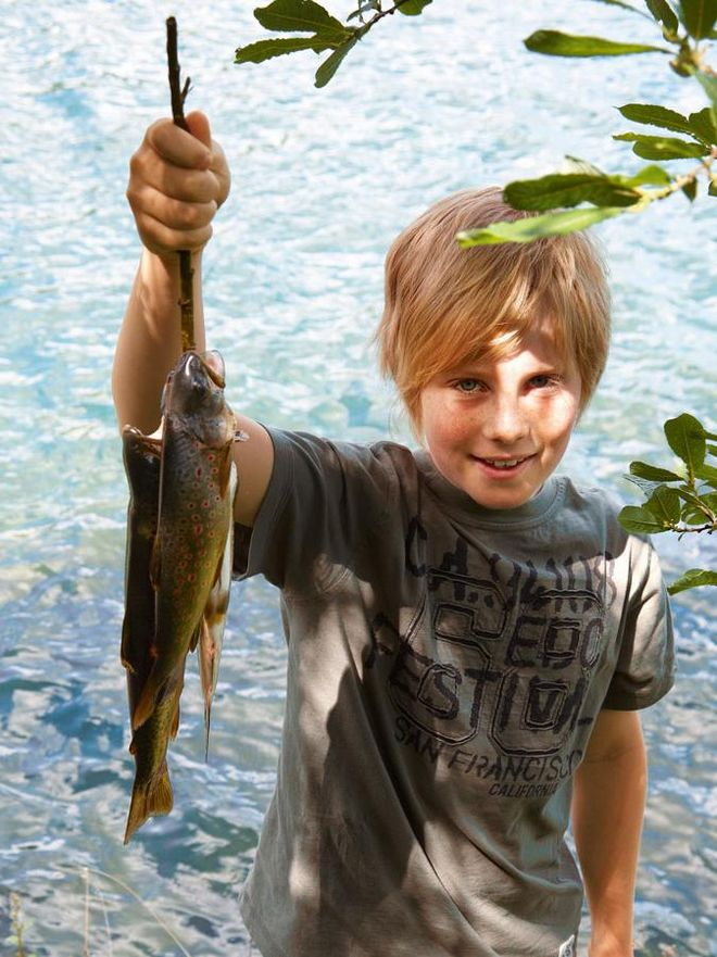 Child with catched fish