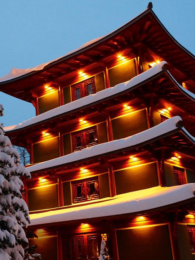 The illuminated Chinatower in winter from the outside in the Hotel Hochschober